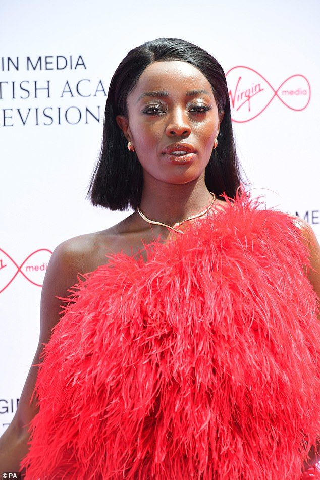 Turning heads: The TV presenter, 33, looked sensational as she posed in the statement ruby gown and white stilettos