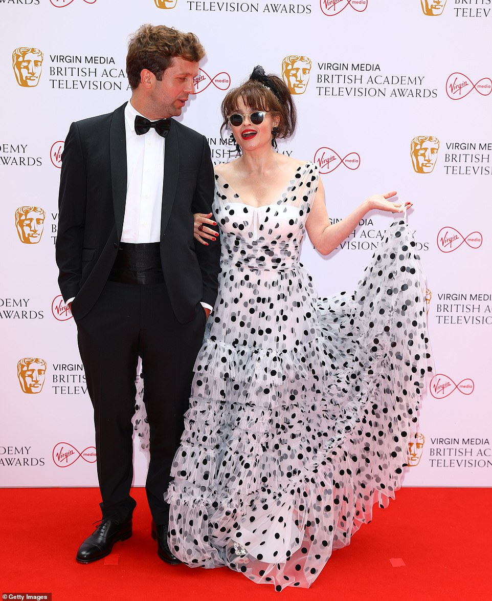 Dapper gent: She was joined on the red carpet by her beau Rye Holmboe, who cut a dapper figure in a classic black tuxedo