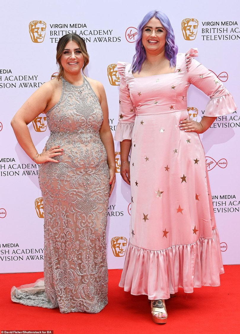 Television break: Ellie and Izzi Warner took a break from watching TV for Gogglebox to hit the red carpet in stylish dresses
