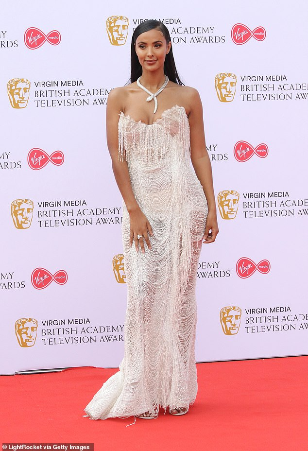 Stunning:The presenter has been a fixture at the awards in recent years, and in 2019 graced the red carpet in a busty sheer tasseled gown