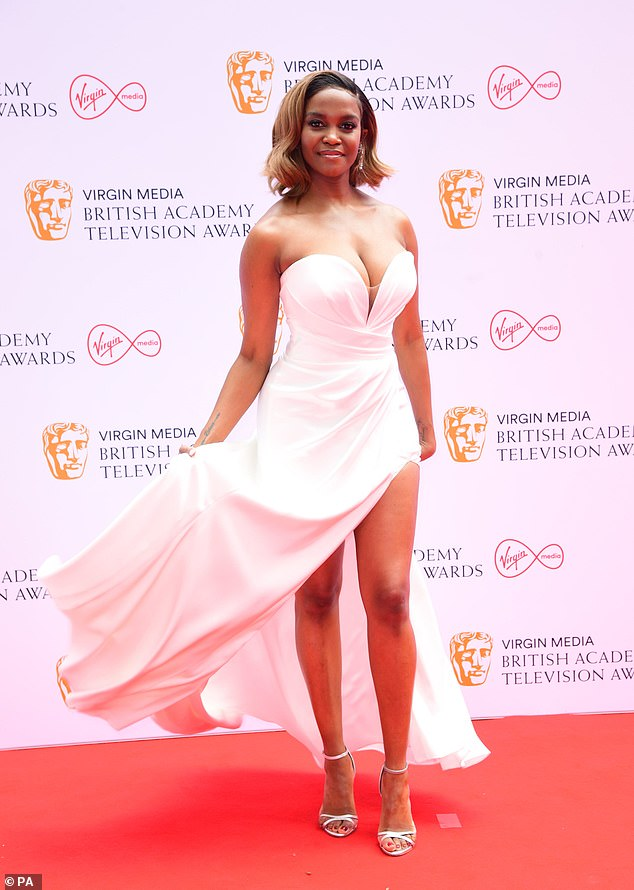 Beautiful: Oti flaunted her endless pins in a plunging white gown with a thigh-high split after arriving for the red carpet at London's Television Centre
