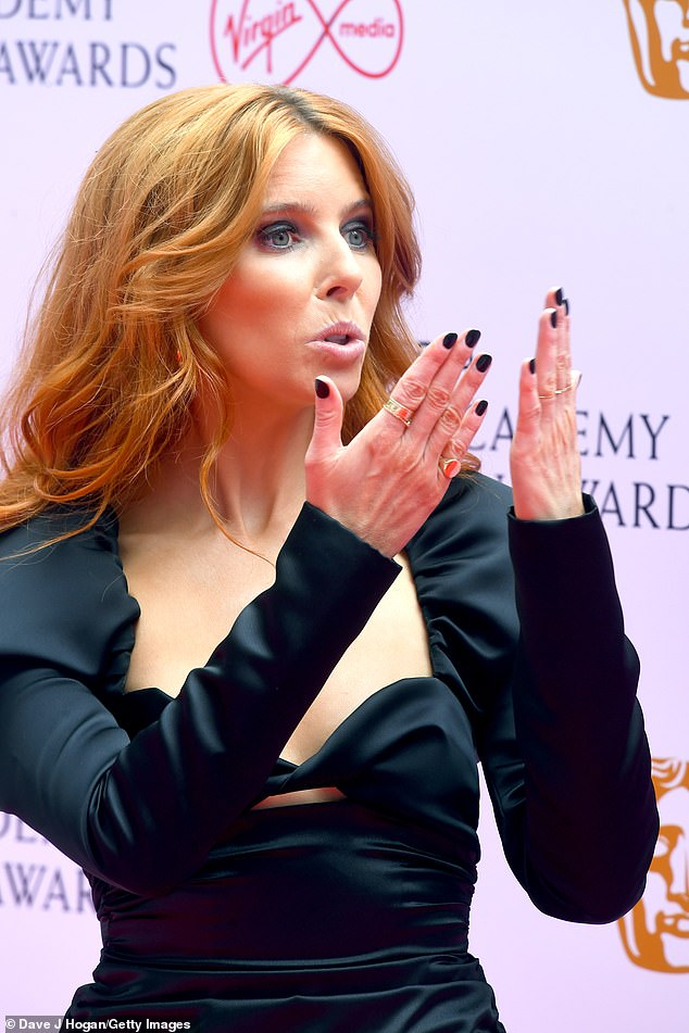 Playful: Upon arriving for the red carpet, Stacey blew a kiss to her fans as she kicked off her hosting duties ahead of the ceremony