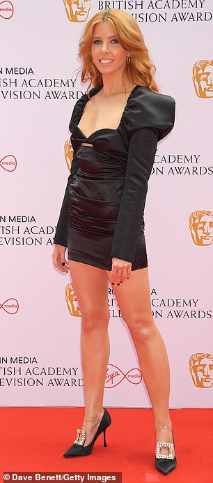 Sex bomb: Stacey put on a leggy display in the fun black dress