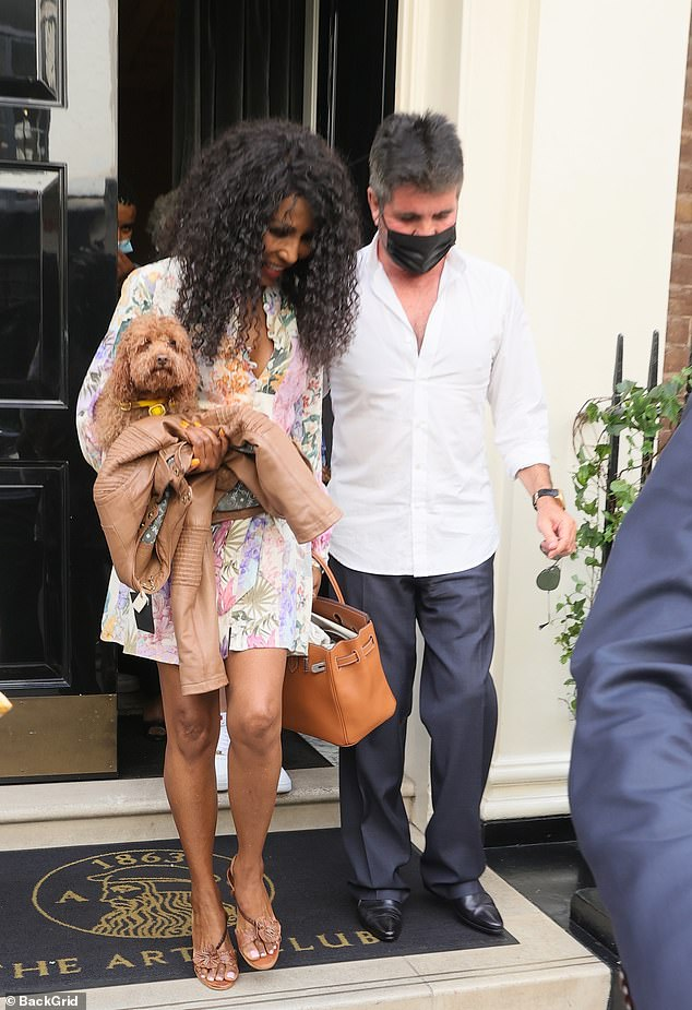 Friendly exes:Simon Cowell, 61, and his partner Lauren Silverman, 43, were joined by the music mogul's ex Sinitta, 52, for lunch in London on Sunday