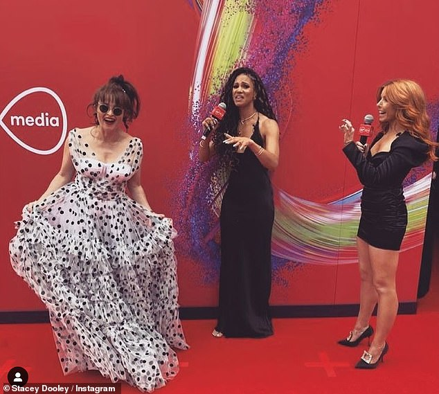 Fun: Helena looked in good spirits as she was interviewed by presenters Vick Hope and Stacey Dooley on the red carpet