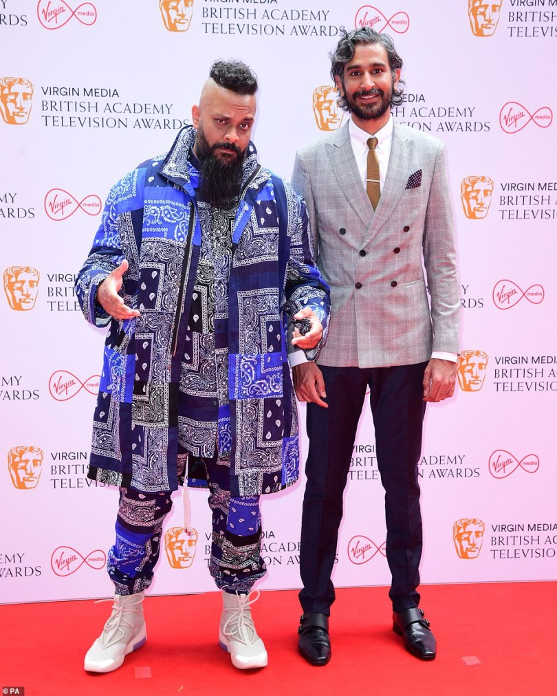 Bold look: Guz Khan (left) went for a bold patterned paisley look as he posed on the expansive red carpet with Arslan Ashraf