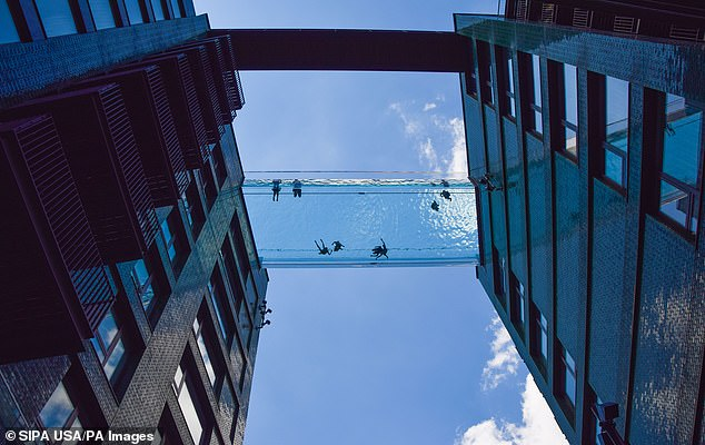 People are seen swimming in the newly opened Sky Pool in London. The 82 ft-long (25-metre) pool — made of acrylic imported from Colorado — is a spectacular addition to the new cityscape at Nine Elms in South London