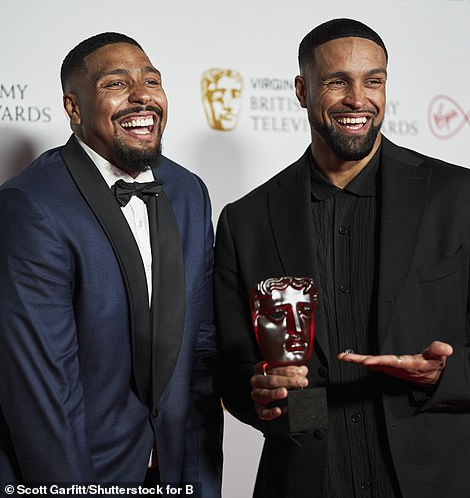 Delighted: The duo happily posed with their well-deserved gong after taking to the stage and delivering a heartfelt acceptance speech