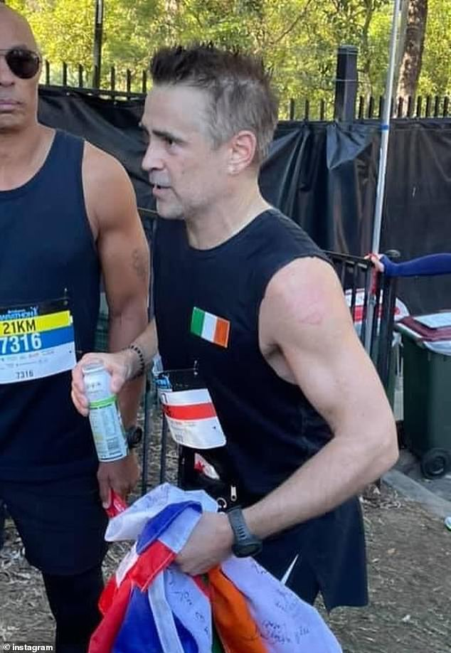 A real local: Colin Farrell (pictured) appears to be embracing his time Down Under after stripping down to his running gear to take part in the annual Brisbane Marathon on Sunday