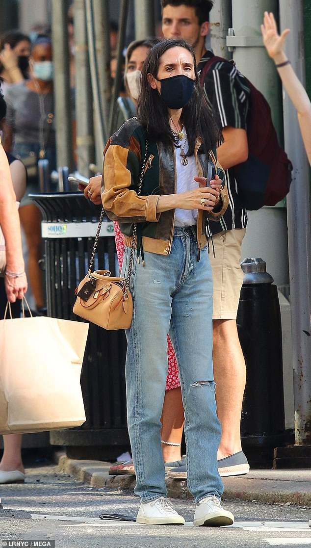 Rare sighting: Jennifer Connelly, 50, was spotted while out shopping with her 10-year-old daughter, Agnes in New York City on Sunday
