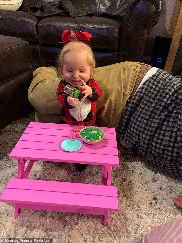 Total is so small, she can only wear newborn clothes and weighs just 7 pounds.  She can fit her Barbie's toy on the picnic table, pictured