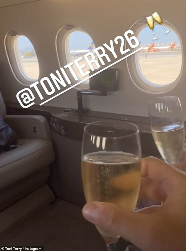 Cheers!After sharing a photograph of herself boarding the plane, she uploaded a boomerang of herself and John celebrating with champagne