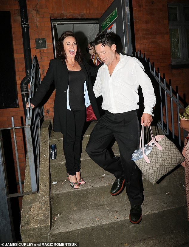 Job well done: Shirley Ballas couldn't keep her giggles at bay on Sunday night following her one-woman show at London's Clapham Grand as she made an exit with her boyfriend Danny Taylor