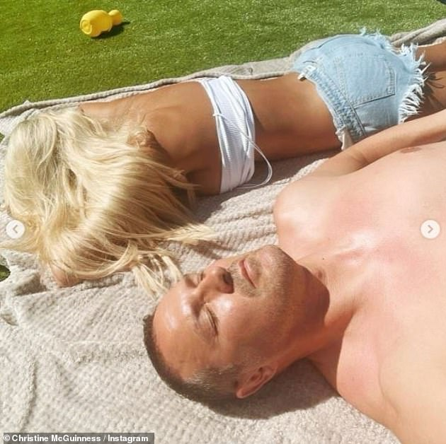 Sunbathing:With the small shorts she wore a skimpy white vest top of which she had pulled the straps down off her shoulders to avoid getting any unsightly tan lines