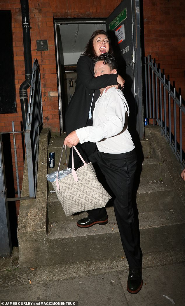 Great night!Danny was seen carrying his other half down the steps of the Clapham venue