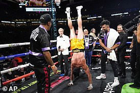The 26-year-old Paul celebrated getting through the fight by performing a handstand in the ring after the exhibition
