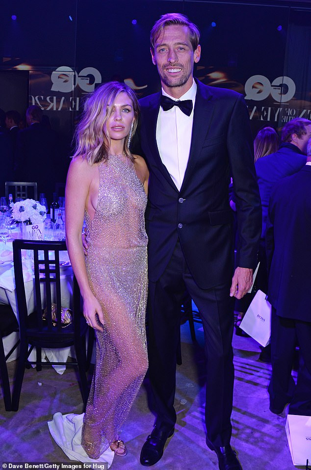 Couple: Peter Crouch has revealed that his wife Abbey Clancy is 'highly critical' and will pick holes in anything he does' (pictured in 2018)