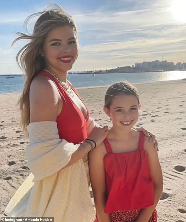 'Sisters':Amanda was every inch the proud mother as she shared a sweet Instagram snap of her lookalike daughters Lexi, 15, and Hollie, nine, while on holiday in Portugal