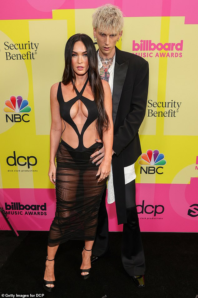 Lucky in Love: The beloved duo never fail to grab attention with their striking looks, with gorgeous Megan in a very racy cutout gown at the Billboard Music Awards (pictured in May)