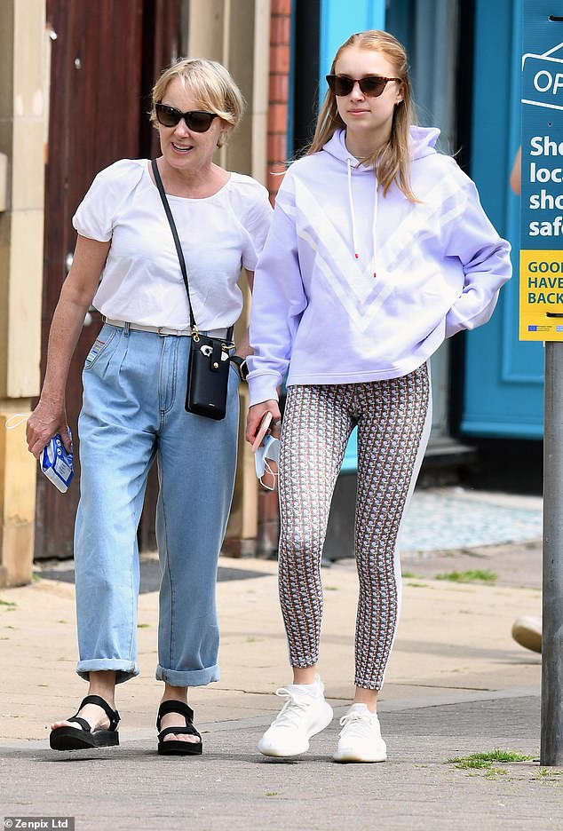 Mother and daughter: Sally Dynevor was seen enjoying a stroll with her youngest daughter Hattie, 17, as they stepped out in Hale, Cheshire, on Monday