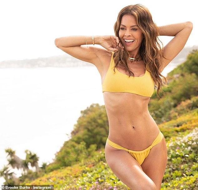Bikini babe:Brooke Burke showed off her stunning bikini body over the weekend as she posed near the coast in Malibu