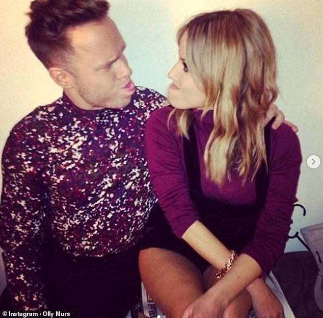 Touching:Caroline Flack is set to be honoured by her close pals Bradley Simmonds and Olly Murs (pictured with the presenter) with a trek to raise money for The Samaritans
