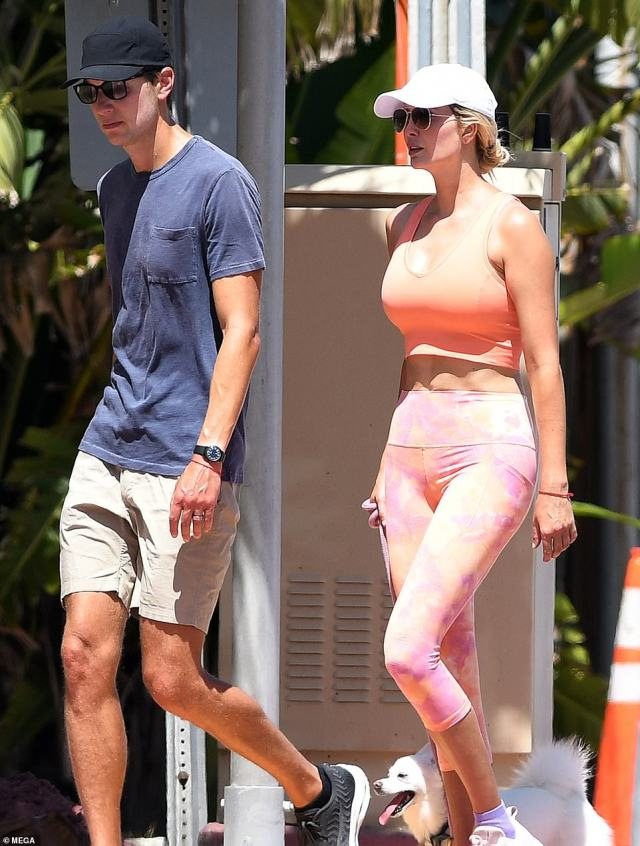 Making moves: Jared looked incredibly tanned as the pair strolled along together - while Ivanka took advantage of the bright weather to show off her toned tummy