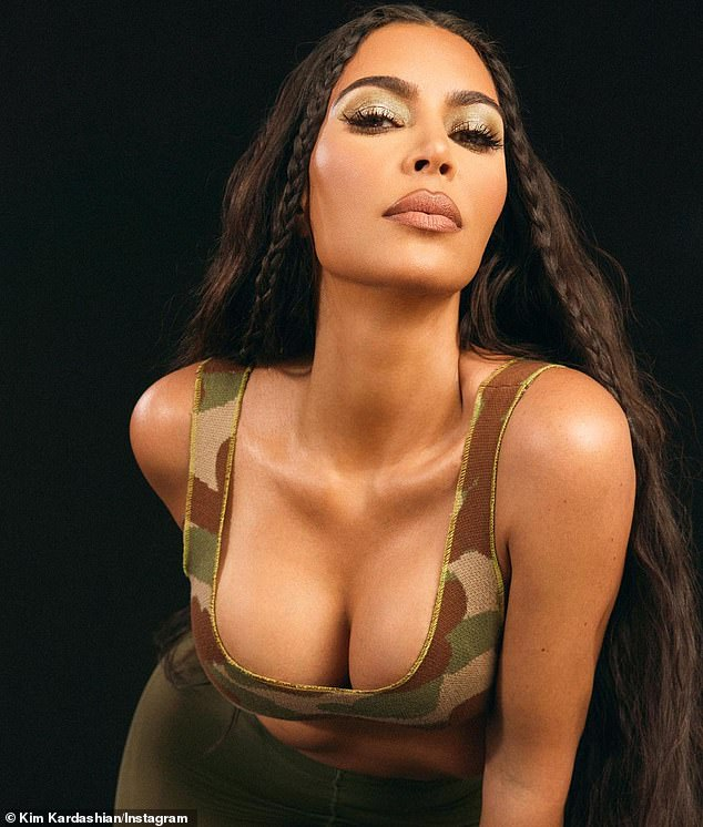 The camo look: She also posed in a camo print tank top for the new collection