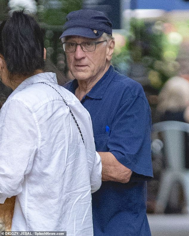He looks healthy: The movie icon had on a blue cap with a matching blue shirt that had a blue pen in the pocket