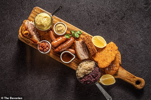 Indulge in $59 The Bavarian Tasting Platter featuring a generous slab of crackling pork belly, the restaurant's famous pork knuckle, German sausages and golden chicken schnitzel