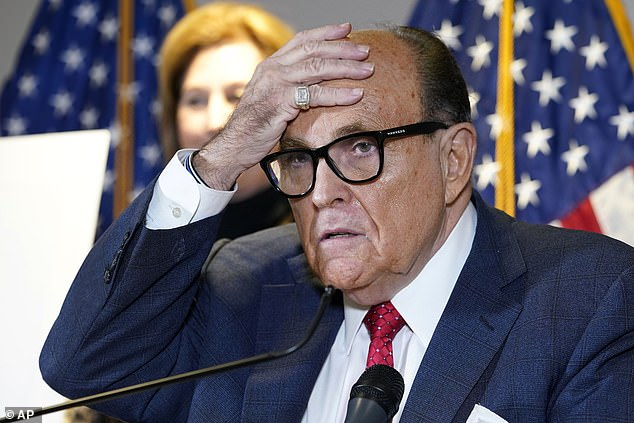 Giuliani is heard suggesting if there were an investigation into Biden, it would 'clear the air really well' and possibly pave the way for Zelensky to visit the U.S.