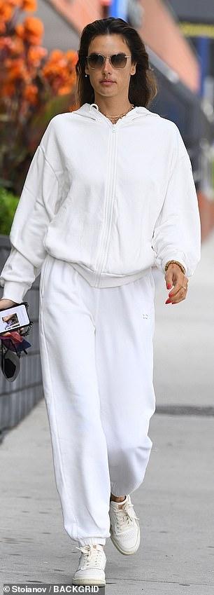 Don't sweat it! Ambrosio warded off a chill wearing a white zip-up jacket and matching sweats