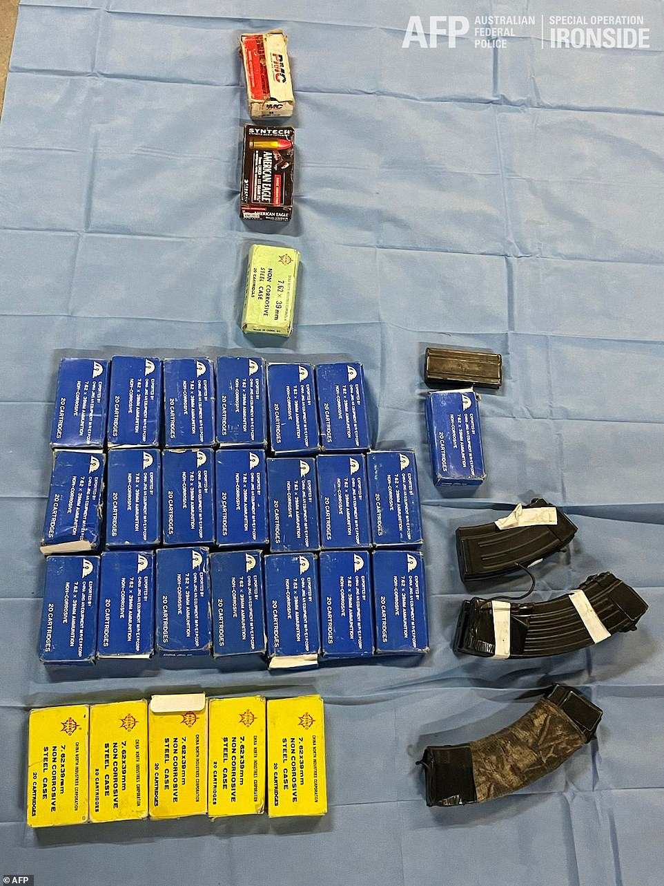 An Interpol red notice has also been for Ayik's arrest, who remains on the run from authorities. Pictured: ammunition seized by authorities