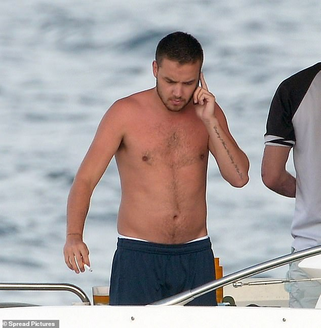 Bloated out:Liam said he struggled to stay sober in One Direction, confessing: ' There were a few pictures of me on a boat and I was all bloated out and I call it my pills-and-booze face' (pictured in 2014)