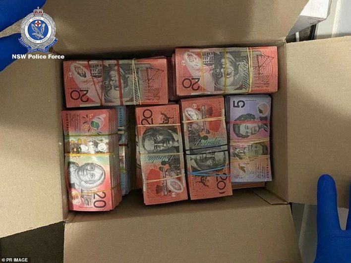 A box of cash wrapped up in rubber bands after it was seized by officers in New South Wales
