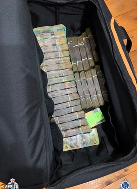 A bag filled with bundles of cash