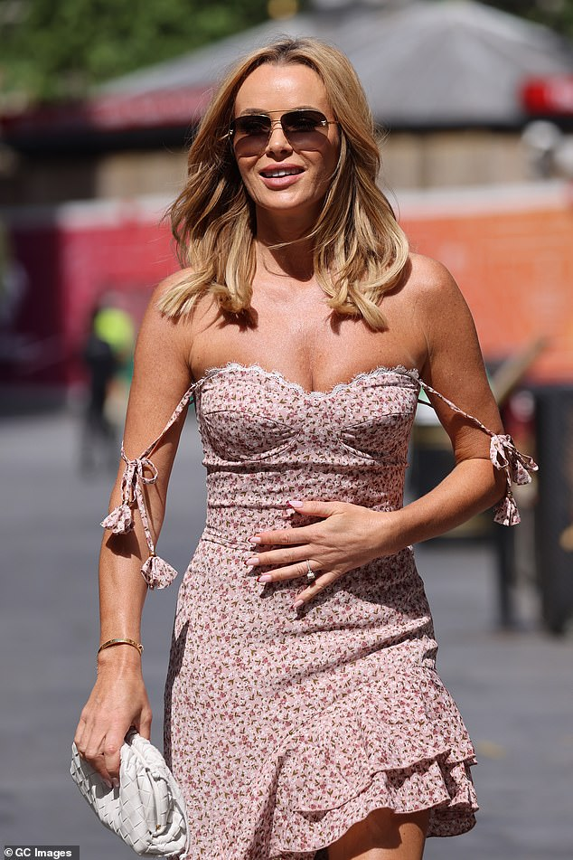 Gorgeous: Her beautiful layered dress from luxury fashion brand Nadine Merabi billowed in the breeze as she walked
