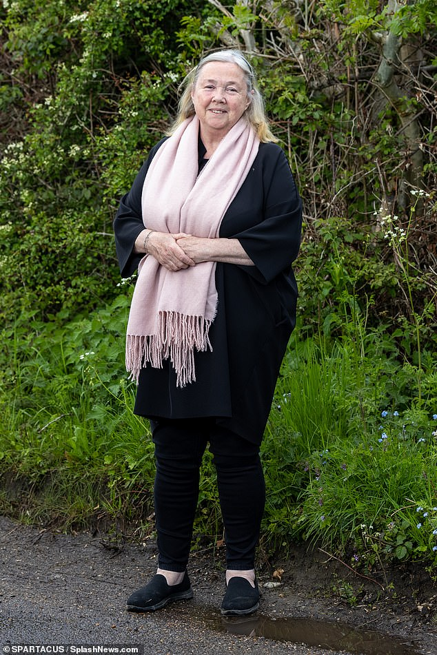 New look: Pauline Quirke, 61, ditched her character's trademark short locks as she stepped out sporting long grey hair in Buckinghamshire on Tuesday
