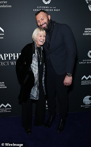 Warm welcome: The former world champion affectionately embraced underwater photographer Valerie Taylor as they posed together on the black carpet