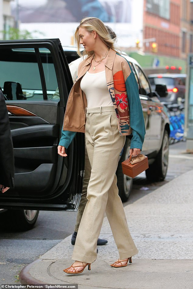 Chic: Always known for putting on a fashionable display, the blonde beauty wore a pair of brown strappy high heels and carried a matching box-shaped bag