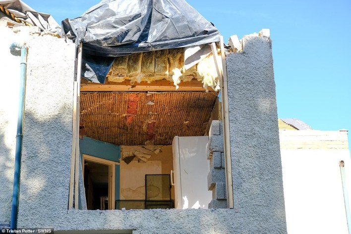 The detached property on Guilford Road in Stoneygate, Leicester, which has been left with its roof missing and rubble scattered all around it after a builder decided to undo the work he'd done following a row about cash