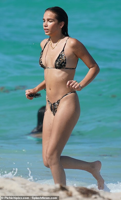 Work it:Hana Cross looked incredible as she enjoyed a fun beach day in Miami, Florida, earlier this week