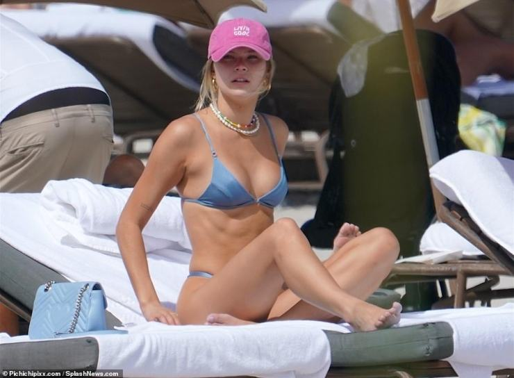 Details: Josie, who previously dated Brody Jenner, finished her swimwear look with a collection of pearl necklaces, gold earrings and a pink baseball cap
