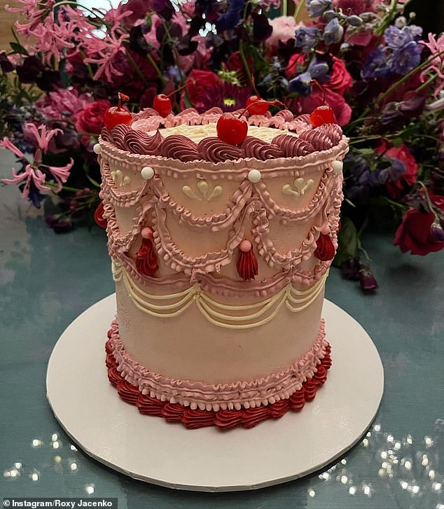 Instagram-worthy: Her cake, inspired by a sister-run cake business in London, made a statement on its own with various pink tones and intricate detail in the icing