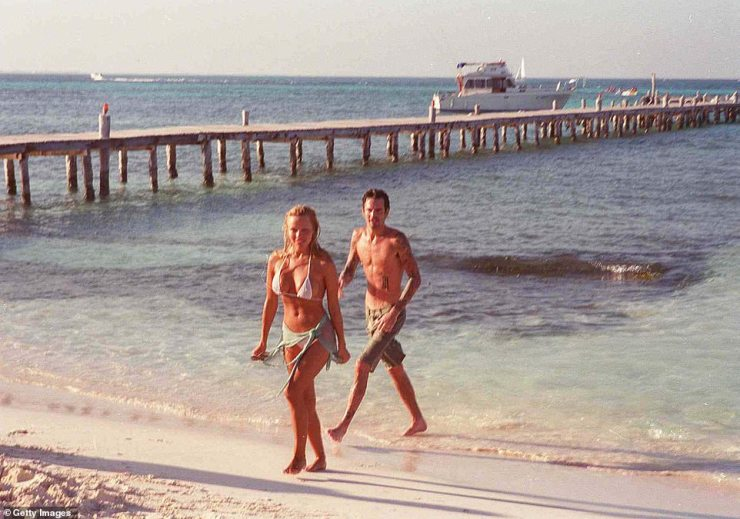And the bride wore... a bikini! The infamous couple hit headlines when they married in beach wear after just a four-day courtship
