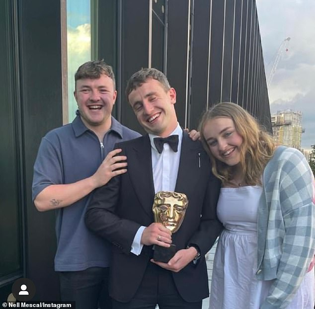 Family: Paul posed with his BAFTA award alongside his brother Donnacha and sister Nell (pictured) in a heartwarming snap she shared to Instagram