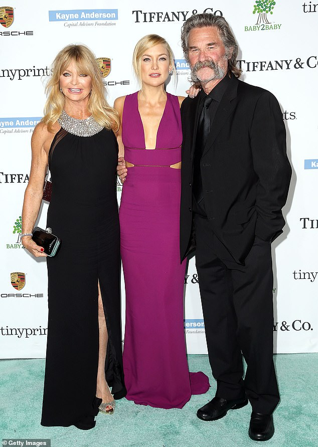 Her famous folks: Kate with mother Goldie Hawn and stepfather Kurt Russell in 2014