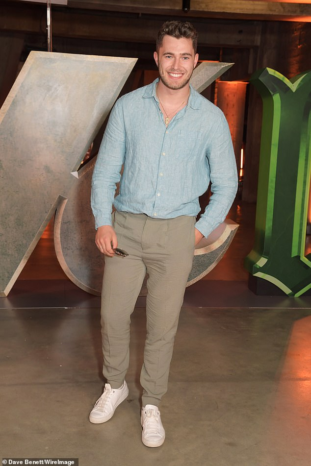 Casual: Curtis opted for a teal shirt with brown trousers and white trainers