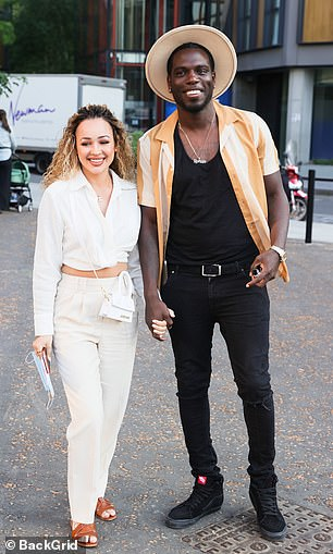 Loved-up: Marcel Somerville attended the event alongside his fiancée Rebecca Vieira with the couple sharing a kiss outside the venue