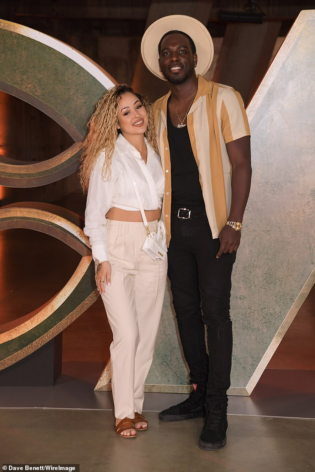 Dressed up: Rebecca showcased her taut midriff four months after giving birth in a cream cropped shirt, paired with matching trousers and tan sandals